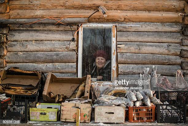 Hasiyal poses for a picture in her shack at a market near the Siberia village of Yangutum on January 22 2016 in Siberia Russia Kamil and his common...