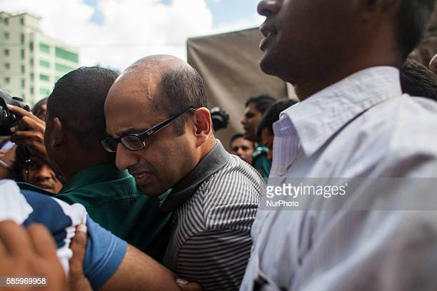 Hasnat Karim a British citizen of Bangladeshi origin is surrounded by police officers in Dhaka on August 4 2016 before appearing in court Bangladeshi...