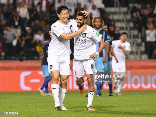 Hassan Al Haydos of AlSadd Sports Club celebrates after scoring his team's second goal which was then ruled offside by VAR with Nam Taehee of AlSadd...