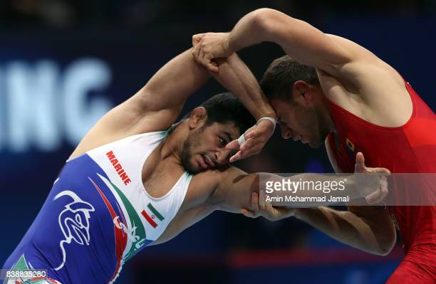 Hassan Aliazam Yazdanicharati of Iran in action against Piotr Ianulov of Moldovia during World Wrestling Championships in 86kg 1/8 Freestyle Seniors...