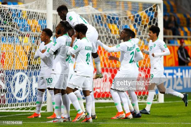 Hassan Altambakti of Saudi Arabia celebrates with his team mates after scoring his team's second goal from the penalty spot during the 2019 FIFA U20...