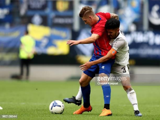 Hassan Amin of Mannheim challenges Jan Holldack of Uerdingen during the Third League Playoff first leg match between KFC Uerdingen and Waldhof...