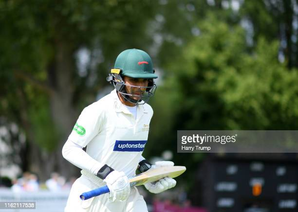 Hassan Azad of Leicestershire makes his way out to bat during Day One of the Specsavers County Championship Division Two match between...