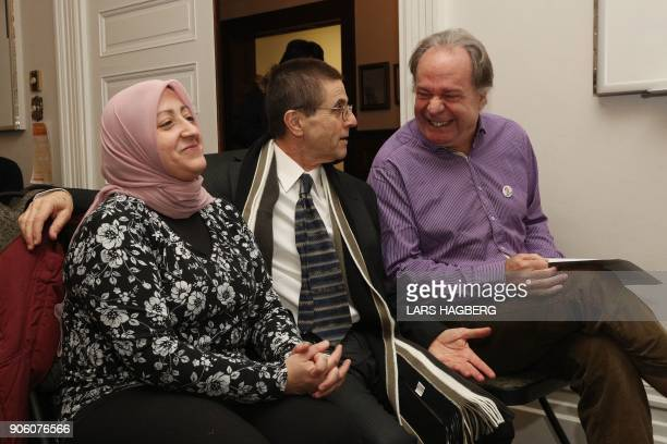Hassan Diab a Canadian university professor and his wife Rania Tfaily greet friends at Amensty International Canada in Ottawa Ontario on January 17...