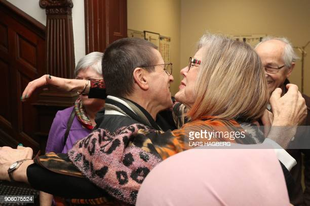 Hassan Diab a Canadian university professor greets friends at Amensty International Canada in Ottawa Ontario on January 17 2018 after returning to...