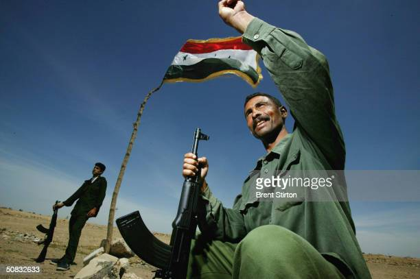 Hassan Falib Ali and Ali Dulame members of the new Iraqi army pose for a portrait May 6 2004 in Fallujah Iraq Although not yet involved in active...