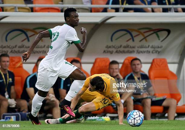 Hassan Fallatah of Saudi Arabia in action against Robbie Kruse of Australia during the 2018 FIFA World Cup Qualifiers match between Saudi Arabia and...