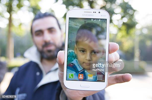 VOORSCHOTEN Hassan from Damascus shows a photo of his son Ahmad on his mobile phone On Friday night three buses with around 125 refugees arrived from...