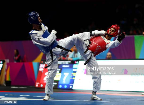Hassan Haider of Great Britain and Yeldos Yskak of Kazakhstan during their round 32 match of the Men's 58kg division at The World Taekwondo...