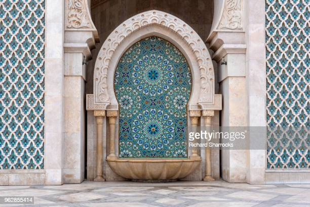 hassan ii mosque, casablanca - stone cleansing fountain - mosque hassan ii stock photos and pictures