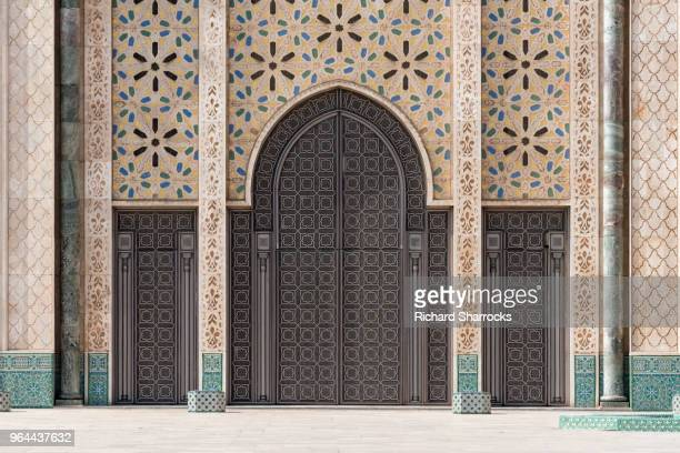 hassan ii mosque doors - casablanca, morocco - mosque hassan ii stock photos and pictures