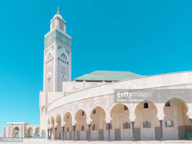 hassan ii mosque in casablanca on the blue cloudless sky background. - mosque stock pictures, royalty-free photos & images