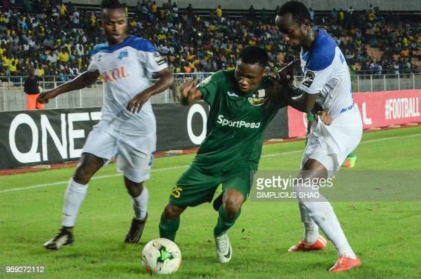 Hassan Khamis Ramadhan of Tanzanias Young Africans vies a ball with Thierry Manzi of Rwandas Rayon Sports during their group match of CAF...