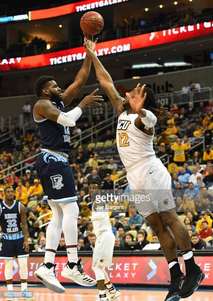 Hassan Martin of the Rhode Island Rams takes a shot in front of Mo AlieCox of the Virginia Commonwealth Rams during the championship game of the...