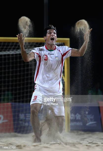 Hassan Mobarhan Abdollahi of Iran celebrates victory during the Beach Soccer Men's Gold Medal Match between Iran and China on Day 5 of the 3rd Asian...