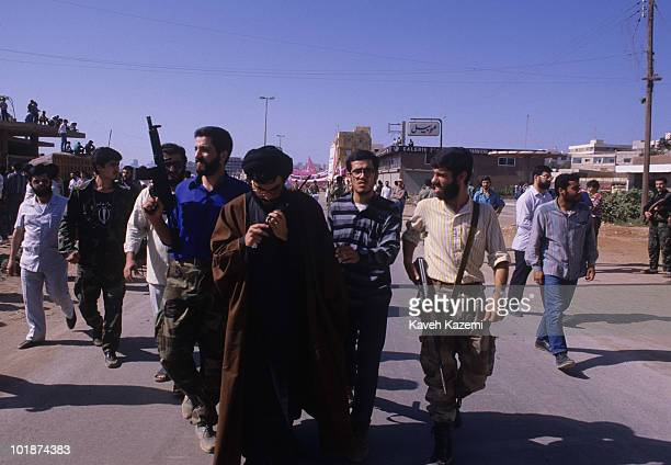 Hassan Nasrallah, in his early days of rising to power, surrounded by bodyguards and talking on a walkie-talkie on Quds Day in the Ouzai suburb of...