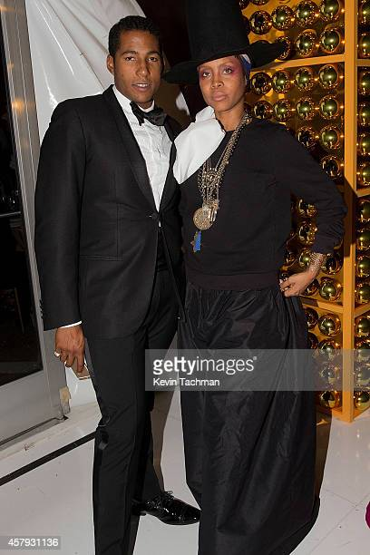 Hassan Pierre and Erykah Badu attend the TWO x TWO For AIDS And Art 2014 Gala and Auction on October 25 2014 in Dallas Texas
