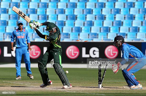 Hassan Razza of Pakistan is bowled by Sarfaraz Khan of India during the ICC U19 Cricket World Cup 2014 match between India and Pakistan at the Dubai...