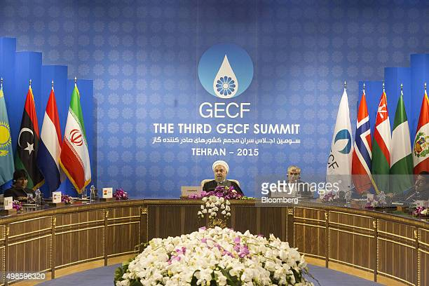 Hassan Rouhani Iran's president center sits with representatives of state during the Gas Exporting Countries Forum summit in Tehran Iran on Monday...