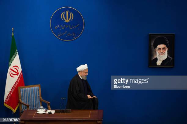 Hassan Rouhani Iran's president departs after holding a news conference to mark the 39th anniversary of the Islamic Revolution in Tehran Iran on...