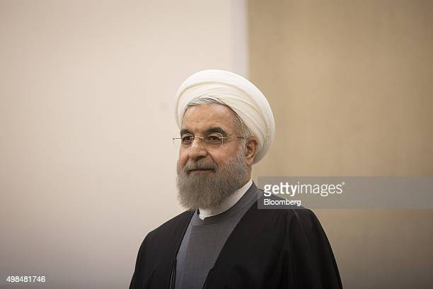 Hassan Rouhani Iran's president listens during a news conference alongside Vladimir Putin Russia's president not pictured at the Gas Exporting...