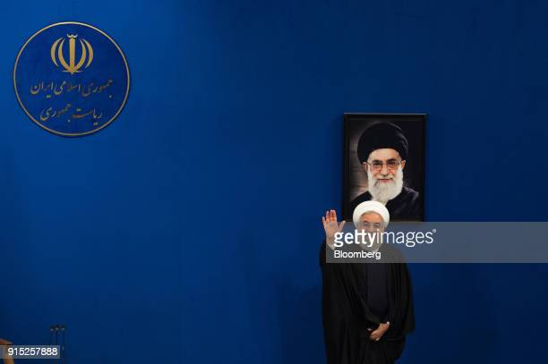 Hassan Rouhani Iran's president waves as he departs a news conference to mark the 39th anniversary of the Islamic Revolution in Tehran Iran on...