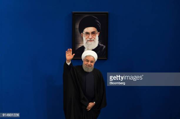 Hassan Rouhani Iran's president waves before leaving a news conference to mark the 39th anniversary of the Islamic Revolution in Tehran Iran on...