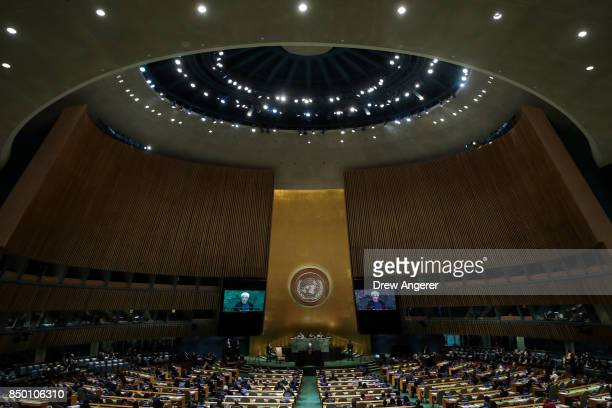 Hassan Rouhani President of the Islamic Republic of Iran is displayed on monitors as he addresses the United Nations General Assembly at UN...