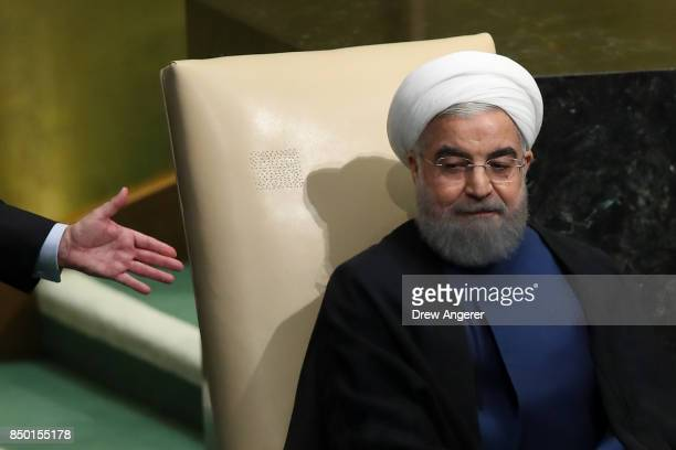 Hassan Rouhani President of the Islamic Republic of Iran is escorted offstage after speaking to the United Nations General Assembly at UN...