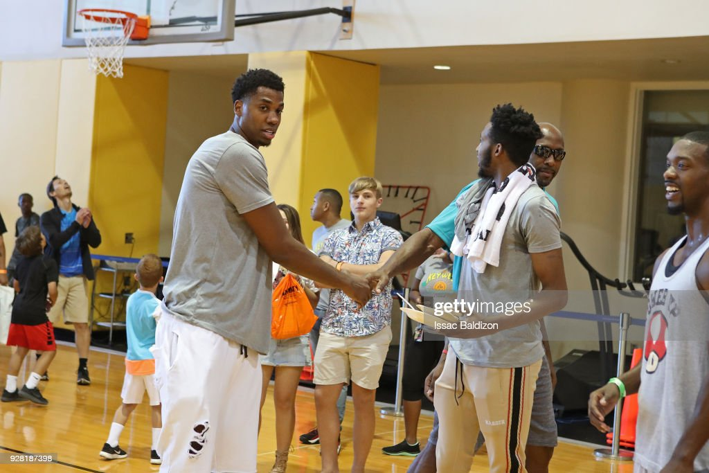Hassan Whiteside #21 and Derrick Jones Jr. #5 of the Miami Heat participate in the 2018 Family Festival at the American Airlines Area on March 4, 2018 in Miami, Florida.
