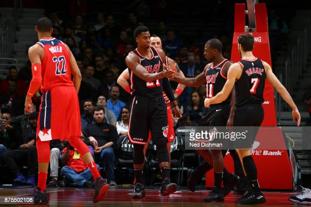 Hassan Whiteside and Dion Waiters of the Miami Heat react against the Washington Wizards on November 17 2017 at Capital One Arena in Washington DC...