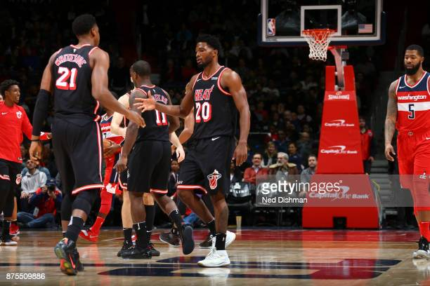 Hassan Whiteside and Justise Winslow of the Miami Heat react against the Washington Wizards on November 17 2017 at Capital One Arena in Washington DC...