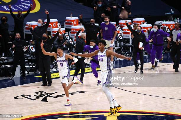 Hassan Whiteside and Tyrese Haliburton of the Sacramento Kings celebrate their last second victory over the Denver Nuggets at Ball Arena on December...