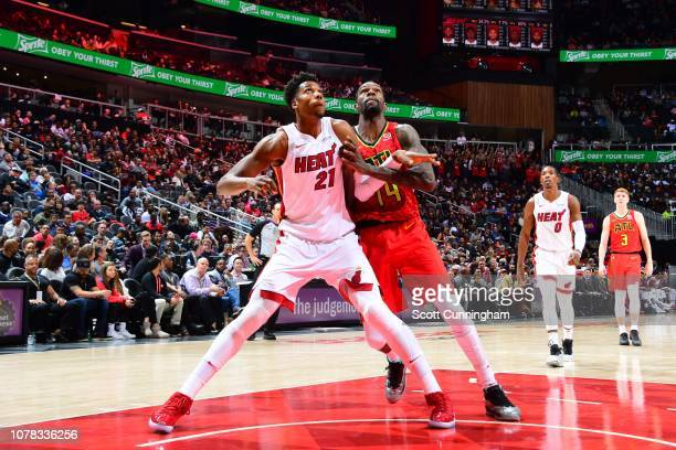 Hassan Whiteside of the Miami Heat and Dewayne Dedmon of the Atlanta Hawks fight for the rebound on January 6 2019 at State Farm Arena in Atlanta...