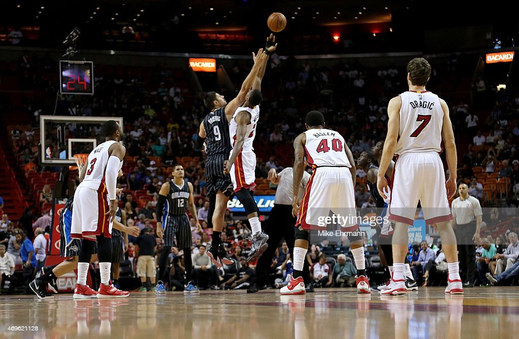 Hassan Whiteside #21 of the Miami Heat and Nikola Vucevic #9 of the Orlando Magic jump ball during a game at American Airlines Arena on April 13, 2015 in Miami, Florida.