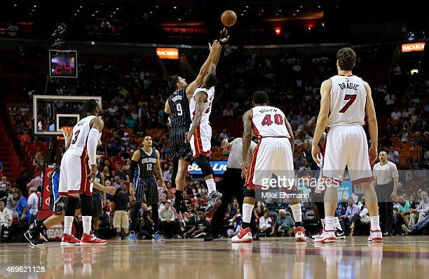 Hassan Whiteside of the Miami Heat and Nikola Vucevic of the Orlando Magic jump ball during a game at American Airlines Arena on April 13 2015 in...