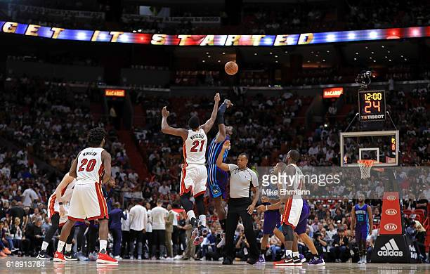 Hassan Whiteside of the Miami Heat and Roy Hibbert of the Charlotte Hornets jump ball during a game at American Airlines Arena on October 28 2016 in...