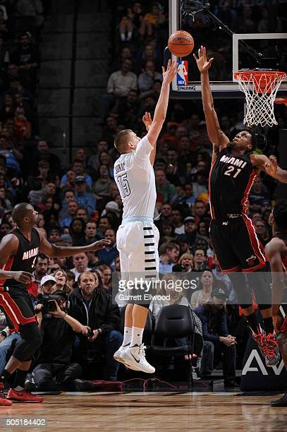 Hassan Whiteside of the Miami Heat blocks Nikola Jokic of the Denver Nuggets on January 15 2016 at the Pepsi Center in Denver Colorado NOTE TO USER...