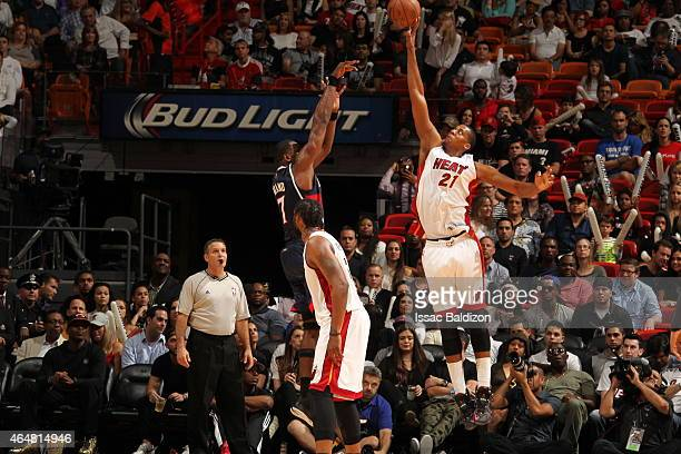 Hassan Whiteside of the Miami Heat blocks the ball against Elton Brand of the Atlanta Hawks on February 28 2015 at American Airlines Arena in Miami...