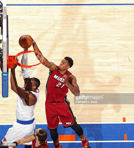 Hassan Whiteside of the Miami Heat blocks the shot of Kevin Seraphin of the New York Knicks on November 27 2015 at Madison Square Garden in New York...