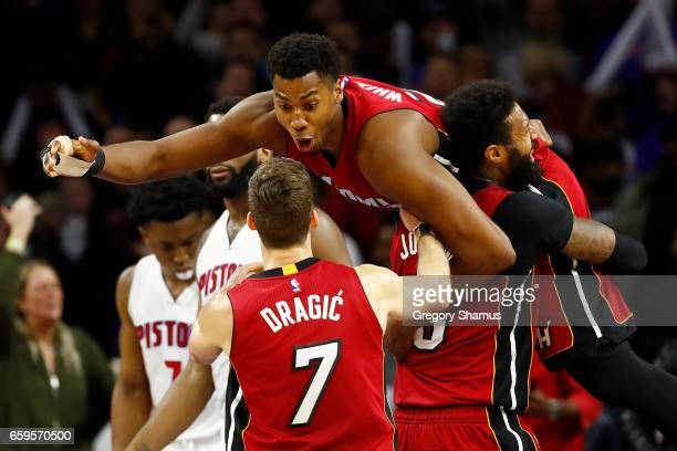 Hassan Whiteside of the Miami Heat celebrates his buzzer beating game winning basket with James Johnson and Goran Dragic in front of Andre Drummond...