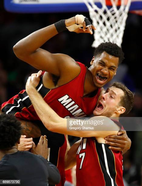 Hassan Whiteside of the Miami Heat celebrates his buzzer beating game winning basket with Goran Dragic while playing the Detroit Pistons at the...
