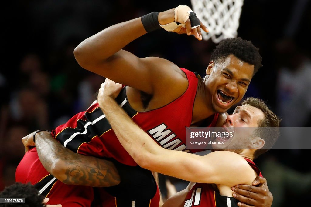 Hassan Whiteside #21 of the Miami Heat celebrates his buzzer beating game winning basket with Goran Dragic #7 while playing the Detroit Pistons at the Palace of Auburn Hills on March 28, 2017 in Auburn Hills, Michigan.