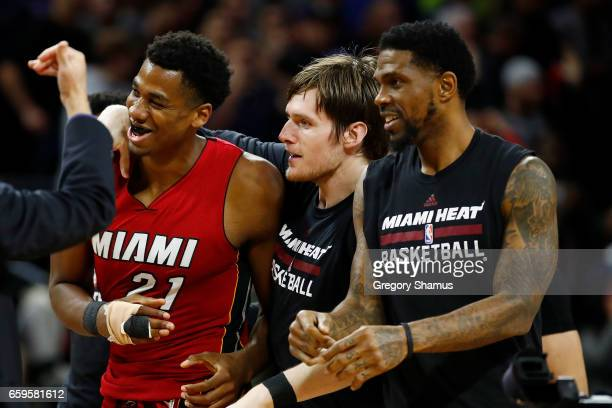Hassan Whiteside of the Miami Heat celebrates his buzzer beating game winning basket with teammates while playing the Detroit Pistons at the Palace...