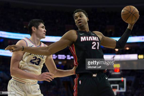 Hassan Whiteside of the Miami Heat controls the ball against Ersan Ilyasova of the Philadelphia 76ers during Game One of the first round of the 2018...