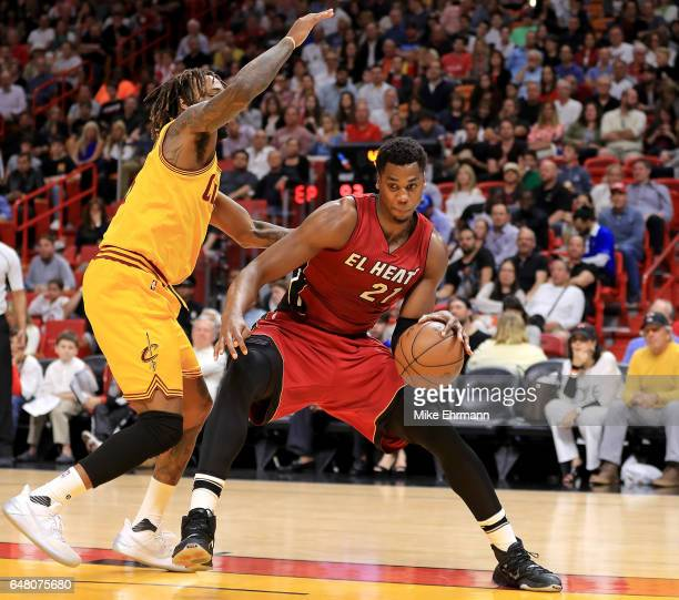 Hassan Whiteside of the Miami Heat drives on Derrick Williams of the Cleveland Cavaliers during a game at American Airlines Arena on March 4 2017 in...