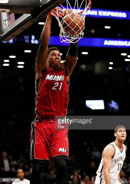 Hassan Whiteside of the Miami Heat dunks as Brook Lopez of the Brooklyn Nets defends at the Barclays Center on January 25 2017 in the Brooklyn...