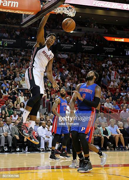 Hassan Whiteside of the Miami Heat dunks on Andre Drummond of the Detroit Pistons during a game at American Airlines Arena on December 22 2015 in...