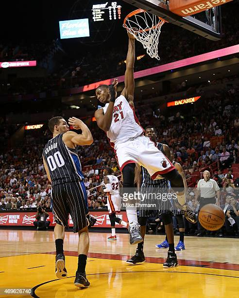 Hassan Whiteside of the Miami Heat dunks over Aaron Gordon of the Orlando Magic during a game at American Airlines Arena on April 13 2015 in Miami...