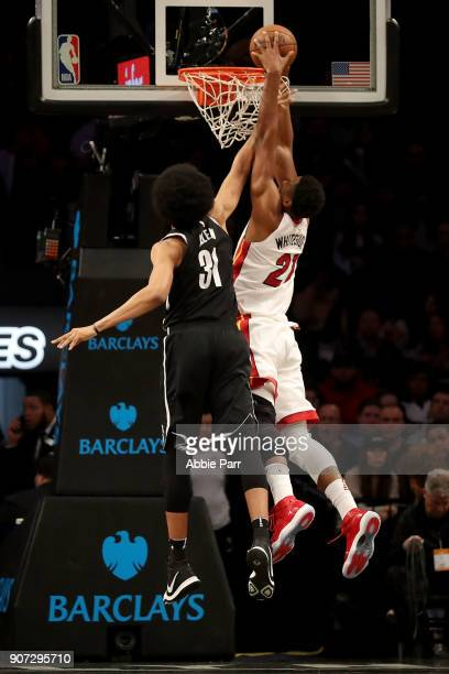 Hassan Whiteside of the Miami Heat dunks the ball against Jarrett Allen of the Brooklyn Nets in the second quarter during their game at Barclays...
